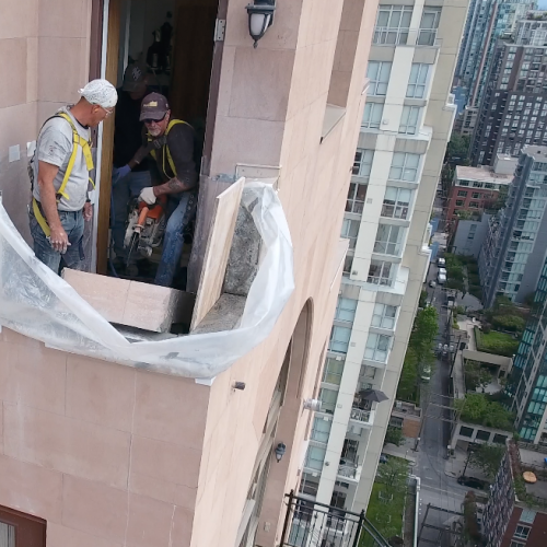 workers working on a skyscraper