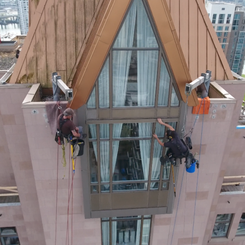 workers working on the roof of a skyscraper
