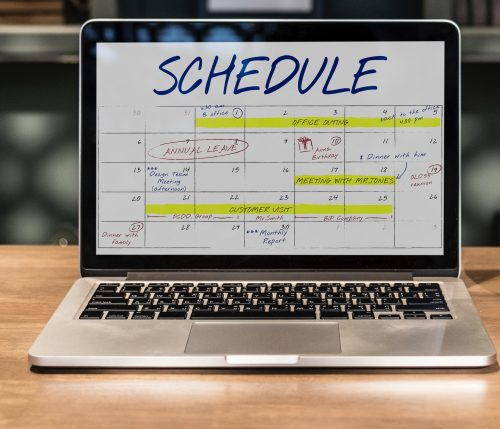 Laptop with a schedule on the screen