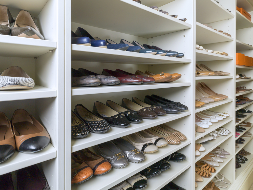 shoes stacked on the closet